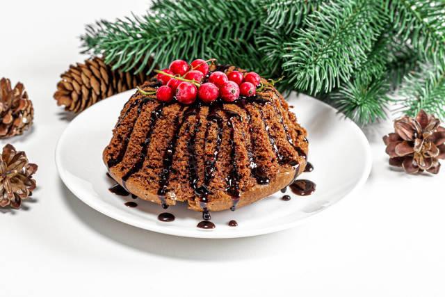 Christmas chocolate cupcake with red currants and Christmas decor