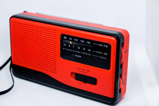 Red mini radio on white background