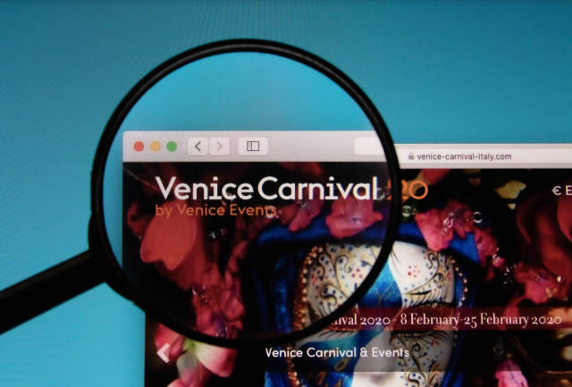 Venice Carnival logo on a computer screen with a magnifying glass