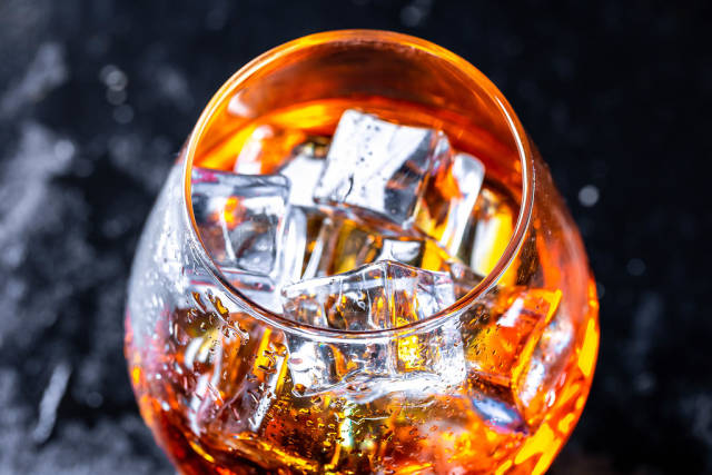 Cognac with ice cubes