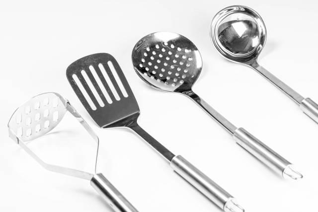 Metal kitchen utensils on white background