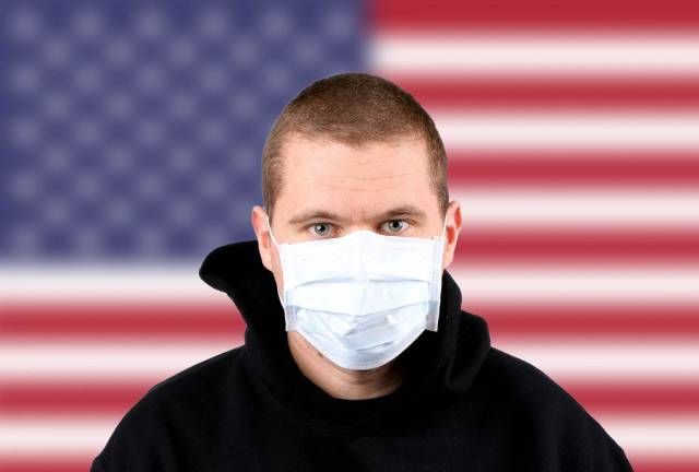 Man wearing protection face mask with flag of USA