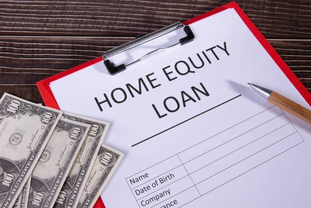 Document with name home equity loan on a desk