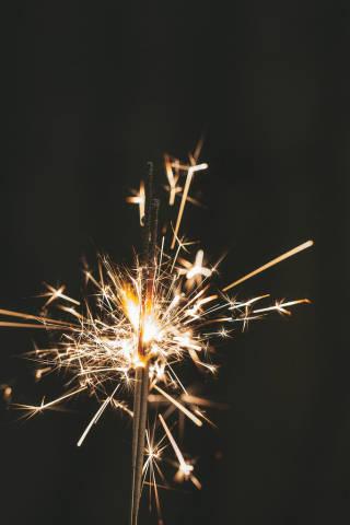 Sparkler burns on a black background