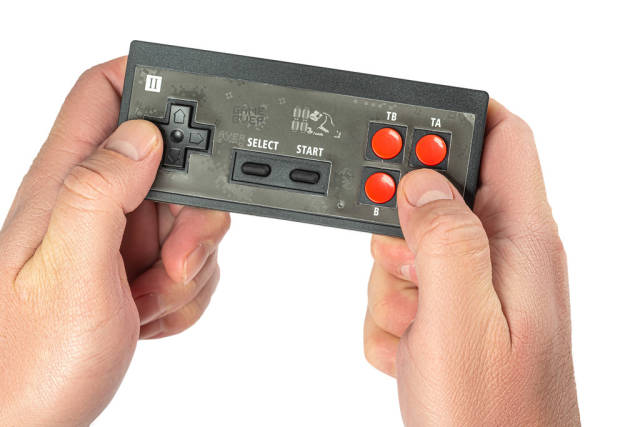 Black joystick in hands on white