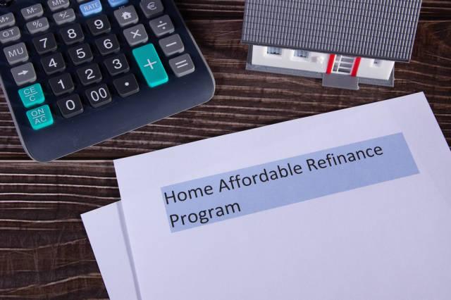 Home Affordable Refinance Program HARP papers on a desk