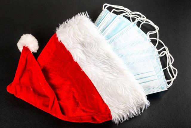 Many medical masks in red santa claus hat