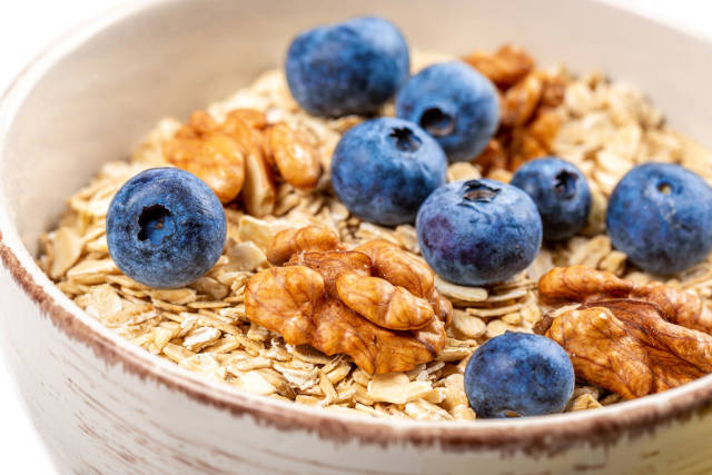 Close-up, oatmeal with walnuts and blueberries