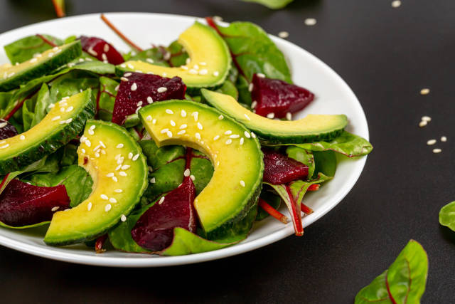 Close-up, salad with boiled beetroot, beet leaves and avocado