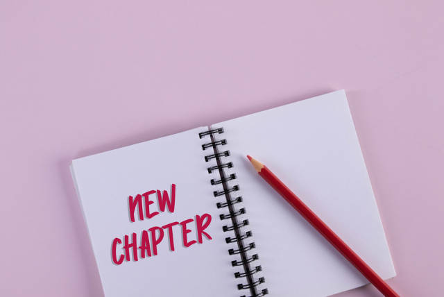 Open notebook with New Chapter text