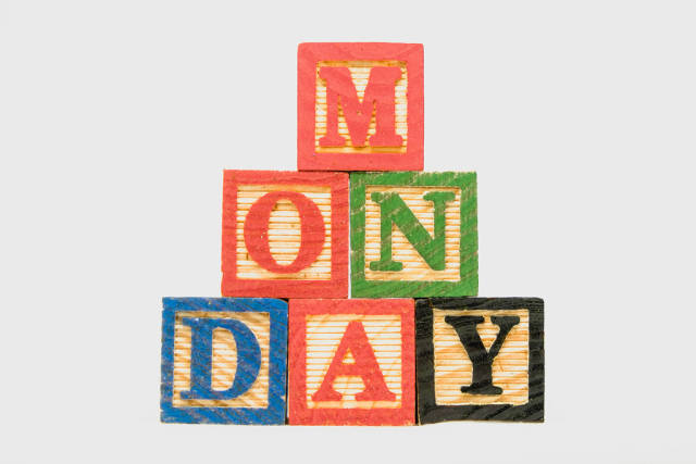 Creative Monday text formed by wooden blocks