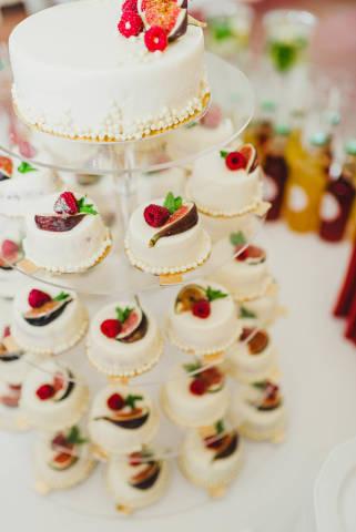 Delicious White Mini Cakes On A  Stand