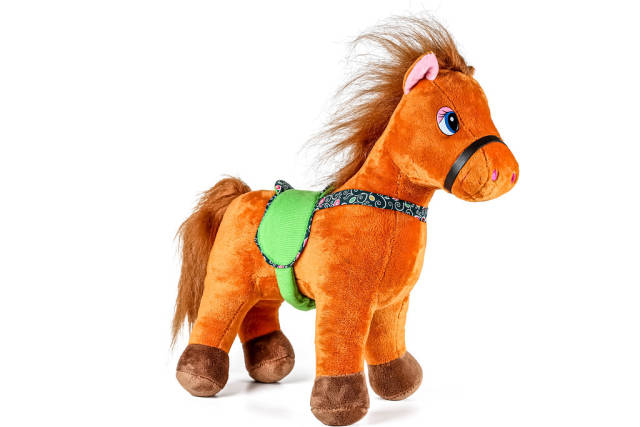 Brown toy horse on white background