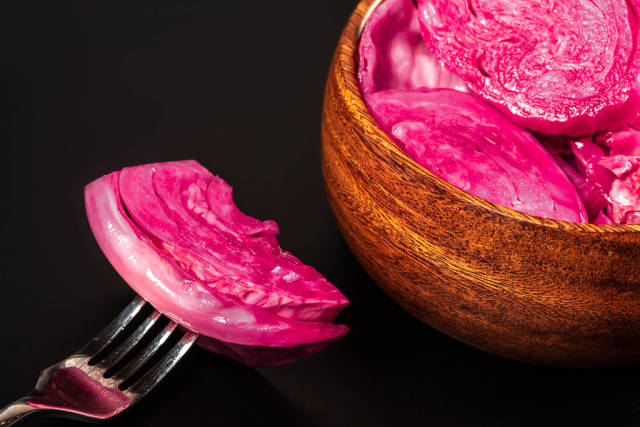Close-up, a piece of pickled cabbage on a fork
