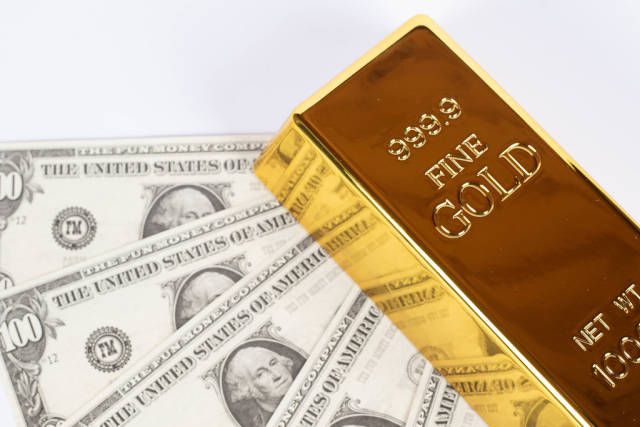 Money and gold bar