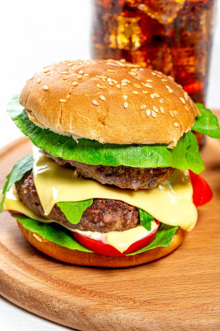 Large Burger with two cutlets, cheese and vegetables