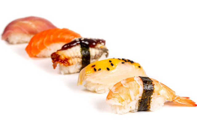 Assortment of nigiri with seafood on a white background
