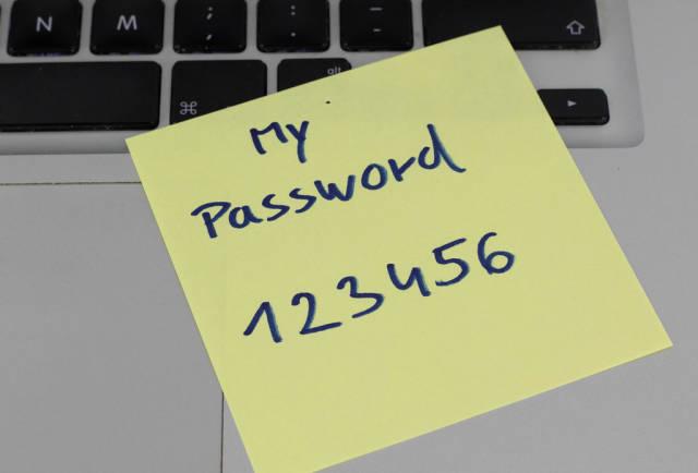 Password 123456 written on a paper