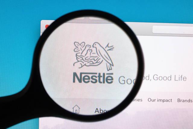 Nestle logo under magnifying glass