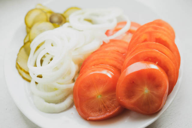 Tomato, onion, and pickle slices