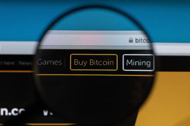 Buy Bitcoin button under magnifying glass