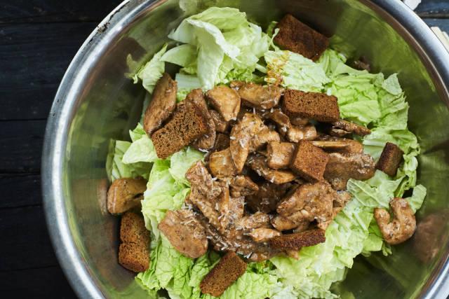 Preparing classic caesar salad