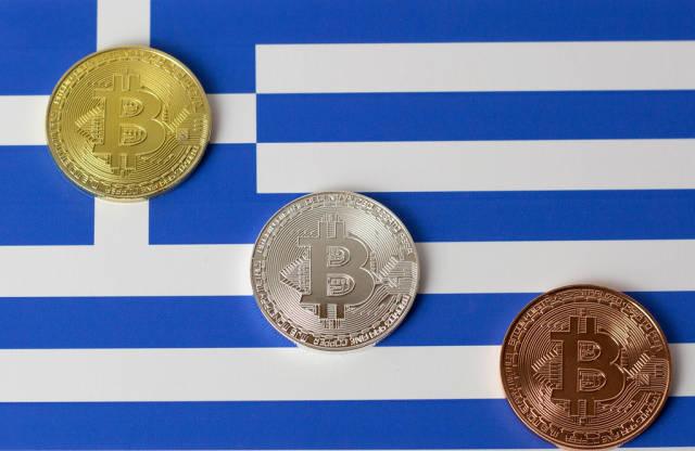 Bitcoins auf griechischer Flagge