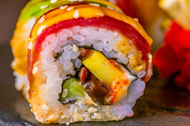 Sushi with salmon, avocado, cheese and caviar