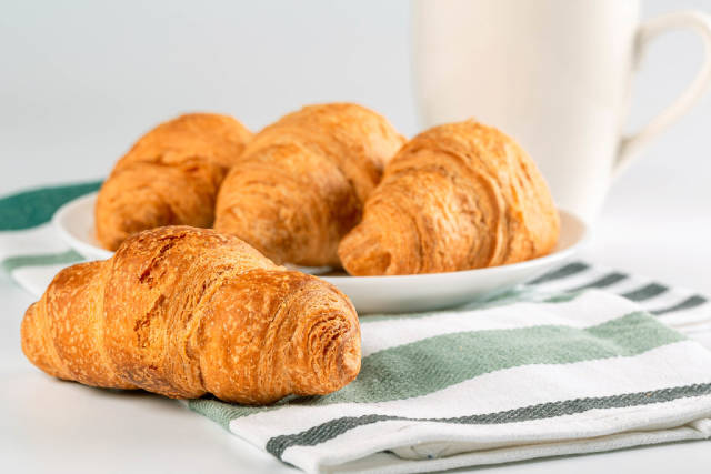 Fresh croissants on plate, concept breakfast