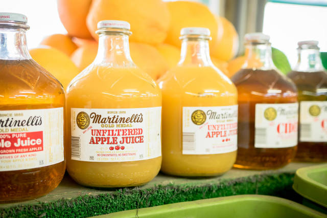 Apple juice glass bottles in market