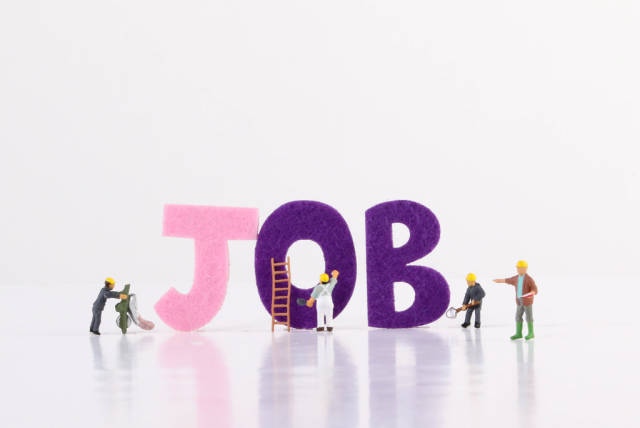 Miniature workers with Job text on white background