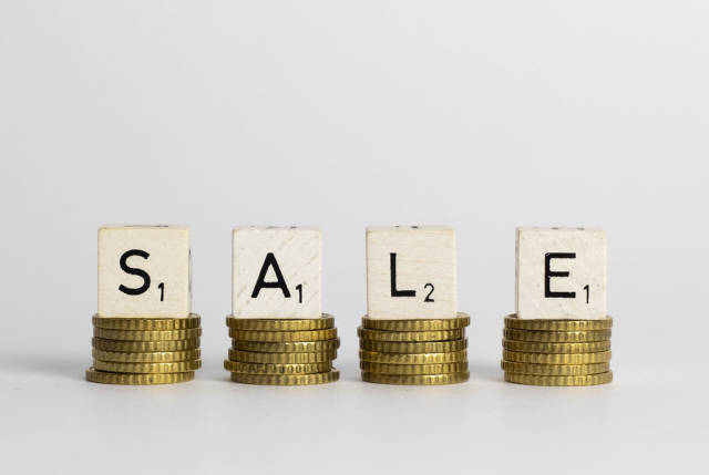 Sale text on coins