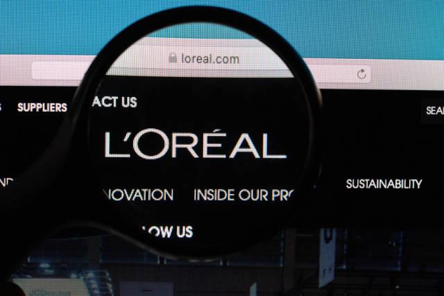 LOREAL logo under magnifying glass