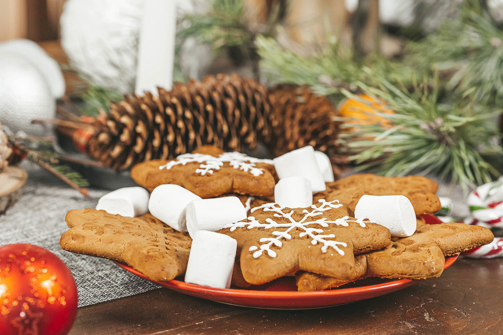 Ginger cookies and marshmallows on the christmas table with decor