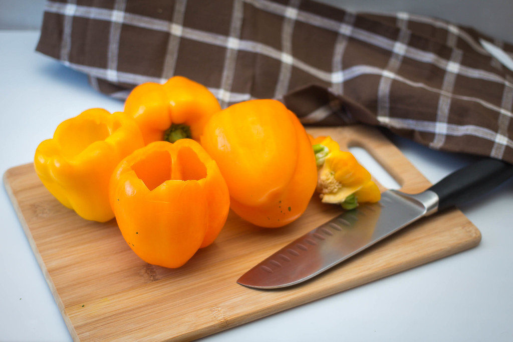 Orange Peppers on a Cutting Board with Knife