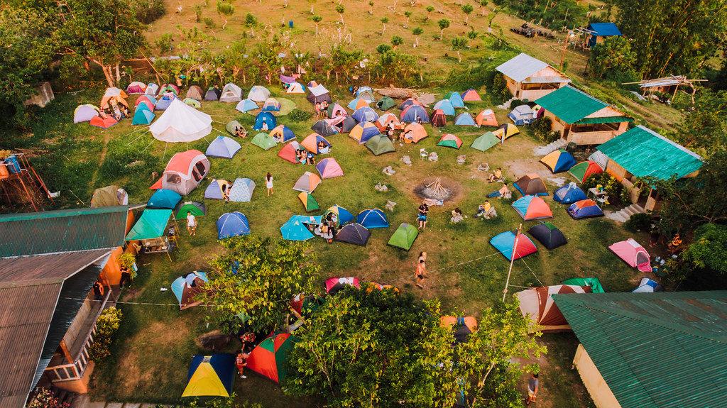 Aerial shot of campers preparing their tents
