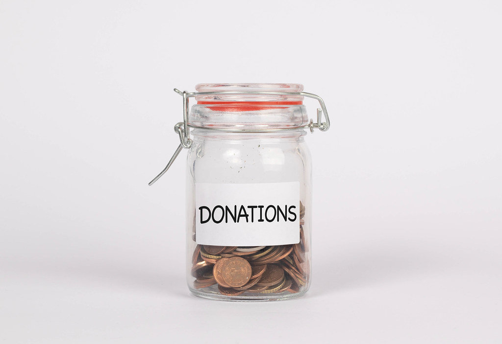 Jar with coins and donate label
