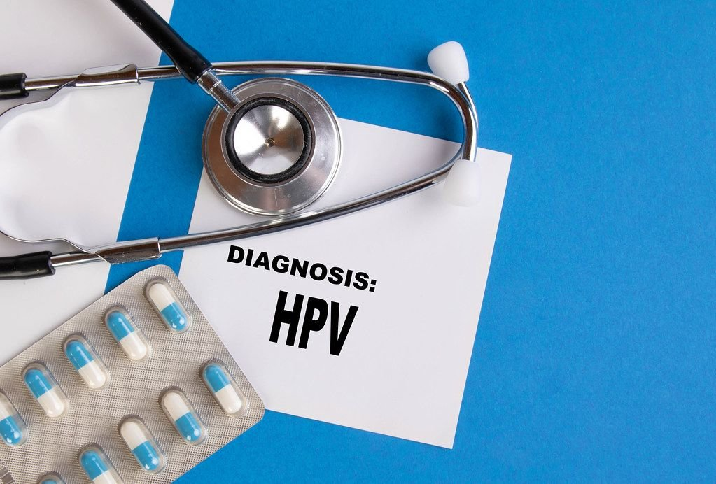 Diagnosis HPV written on medical blue folder
