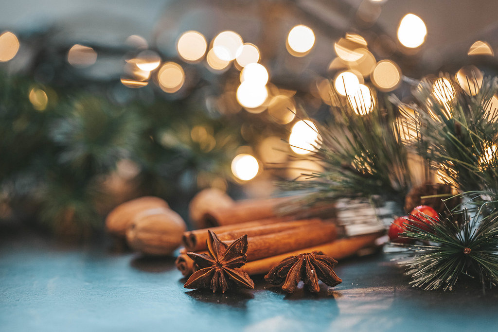 Star anise, cinnamon and nutmeg on Christmas night background with Golden bokeh