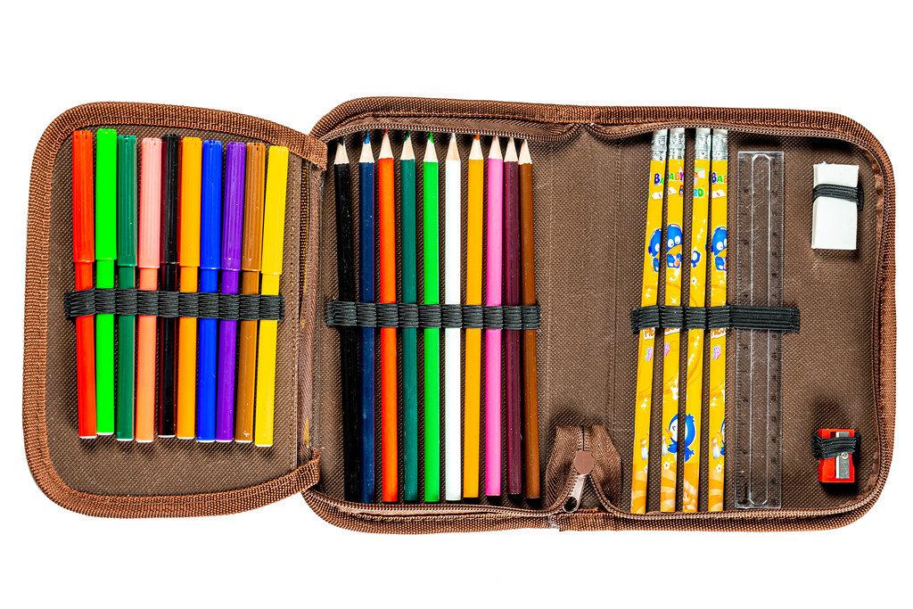 Pencil case full of colored pencils, markers, ruler, eraser and sharpener