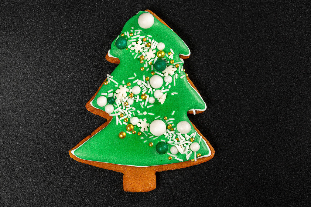 Homemade gingerbread tree on a black background
