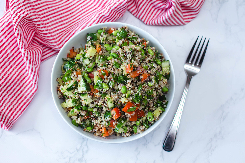 Quinoa Salad with Cucmber, Tomato and Edamame in a White Bowl