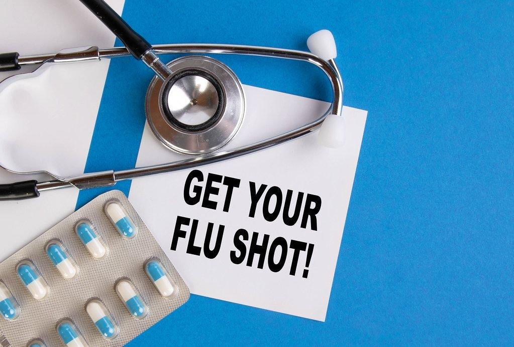 Get your flu shoot written on medical blue folder
