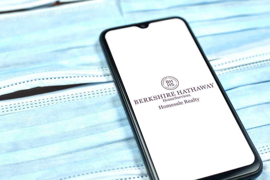 Berkshire Hathaway logo on smartphone screen. Global company during coronavirus crisis