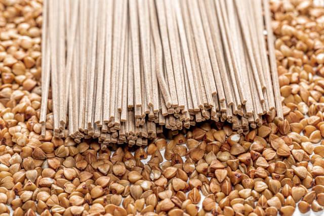Buckwheat noodles soba on the background of raw buckwheat