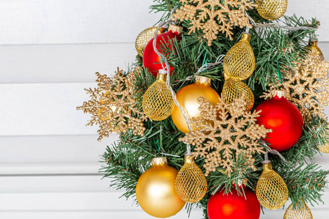 Closeup decorated Christmas tree with garlands and snowflakes