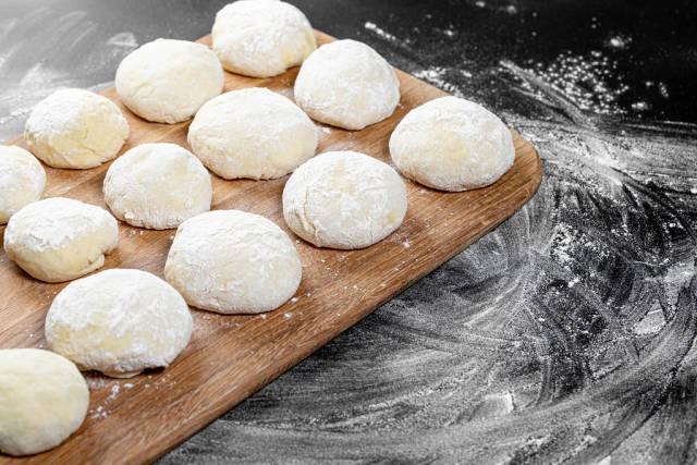Fresh dough on a wooden kitchen Board