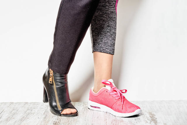 Female wearing official high-hilled shoe and sneaker