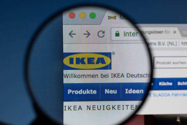 Ikea logo on a computer screen with a magnifying glass