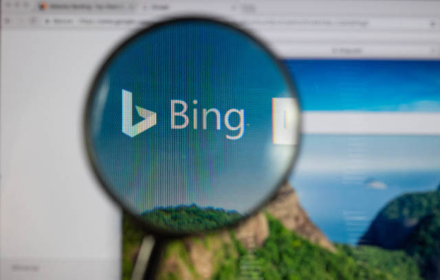 Bing logo on a computer screen with a magnifying glass